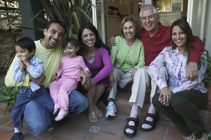 Hispanic family sitting on steps smiling